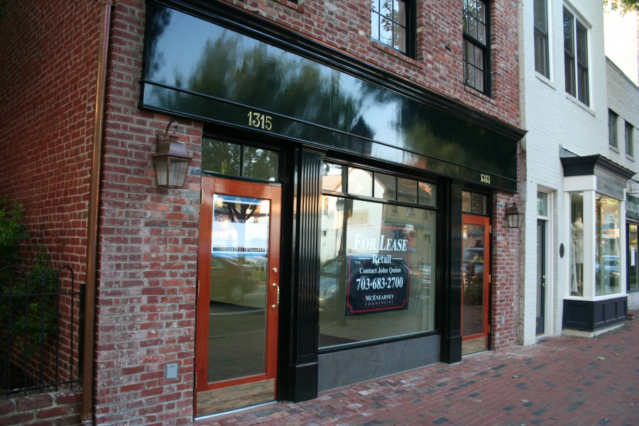 Painting Restoration Of Storefront Facade Refinishing Of